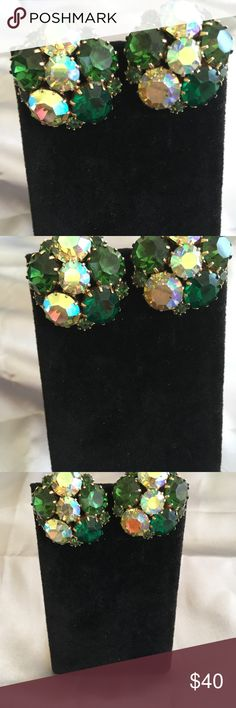 Vintage Vintage KARU Clip On Earrings in varying shades of green, chartreuse, iridescent green and a green/blue/purple aurora borealis finish. KARU Jewelry was first used in the 1940's and lasted through the 1970's. more information is attached. Vintage Jewelry Earrings