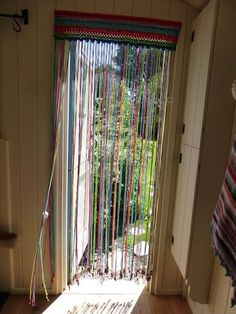 In my last post I left you with an unidentified pic as to what was on my hook as my next cheap and cheerful summer-living project. Well, here it is:  A crochet fly-curtain! And just as the weather tur