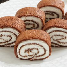 This chocolate crepes recipe is easy to make and the rolls are filled with almond whipped cream.