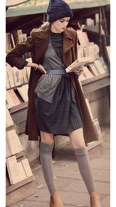 Brown coat, blue stocking hat, high stockings with boots, belted dress