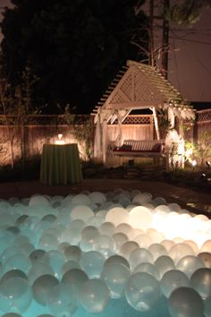 Filled pool of balloons (each balloon had a marble in it to keep it from blowing away) for a wedding. {Swimming Setup Outdoor Décor Decorating Decorations Ideas Inspiration Balloons Floating}