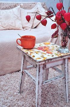 Cute stool: lightly scattered happy floral decoupaged on top. Bottom is heavily-distressed white paint. Adorable!