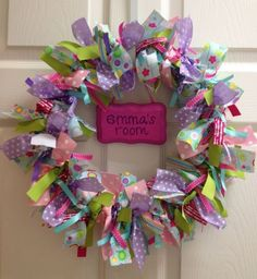 Pretty wreath by Sweet Pickle Jewelry. Would make a great birthday party decoration.