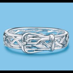 Sterling Silver Buckle Ring .925 Fine Sterling Silver Buckle Ring.  Very feminine style ring.   2 sizes available.  New in box.  Quantity 2:  Size 6  Quantity 2:  Size 7. Jewelry Rings