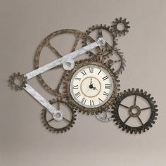 I feel like I could make this, if only I knew how to weld.  Is there a glue or solvent out there that binds metal to metal? WorldMarket.com: Gear Wall Art with Clock