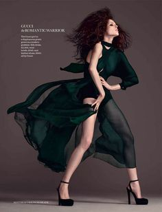 Coco Rocha. Great use of arm angles without hiding the dress. Fierce pose, model, high fashion.