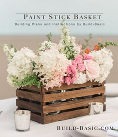 Build a Paint Stick Basket - This beautiful (and inexpensive!) basket is made with a handful of paint stir sticks found at any homecenter, a square dowel, and some staples. Use it as a decorative centerpiece, or as styl… Paint Stir Sticks, Painted Sticks, Rustic Wedding Centerpieces, Diy Centerpieces, Centerpiece Flowers, Graduation Centerpiece, Quinceanera Centerpieces, Flower Arrangement, Wedding Decoration