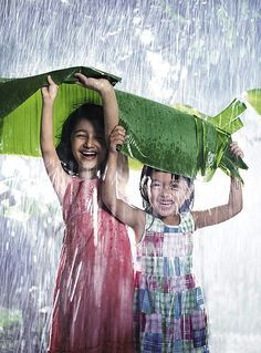 """Who is afraid of a """"little"""" rain? Not these girls! Oh, glorious rain!"""