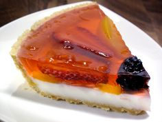 A gelatin pie is a light and refreshing alternative to using a Jell-O mold. I used a shortbread crust with a layer of sweetened condensed milk (cream cheese would also be good) topped with summer fruits suspended in peach gelatin.