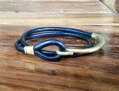 New this season: wrap leather bracelet with a hook closure in textured brass. www.annasukardi.com