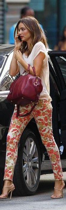 Miranda Kerr- nude sandals, white top, red handbag, and floral skinny jeans