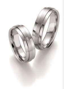 Βέρες Γάμου BRUNO BANANI από Ανοξείδωτο Ατσάλι με Διαμάντι Αναφορά 014162 Ζευγάρι βέρες γάμου από ανοξείδωτο ατσάλι σε λευκό χρώμα. Η γυναικεία βέρα είναι διακοσμημένη με πολύτιμη πέτρα (μπριγιάν). Το μέγεθος προσαρμόζεται ανάλογα με τις ανάγκες του πελάτη. Η τιμή αφορά το ζευγάρι βέρες. Aberdeen, Wedding Rings, Engagement Rings, Rings, Jewels, Enagement Rings, Diamond Engagement Rings, Wedding Ring, Engagement Ring