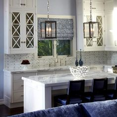 Interior Designer, Patti Smith, designed this Boca Raton open floor kitchen-family room with a restrained palette and a sophisticated mix of materials. Aided by our Paramus Design Associate, Shelley Lovitz, Smith chose our glass and stone #mosaic, 'Valencia', for a #backsplash that subtly balances other elements within the space. #kitcheninspiration #housegoals #artistictictile
