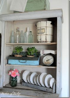 Love this shabby display for a dining hutch - especially the blue vintage toolbox & scale
