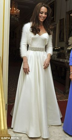 Kate changed into a second wedding gown for the evening celebrations at Buckingham Palace...