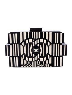 From the Pre-Fall 2014 Collection. Black and ivory plexiglass Chanel Lego Clutch with gunmetal-tone hardware, leather trim, interlocking CC at exterior sides, interior center zip pocket and logo clasp closure.