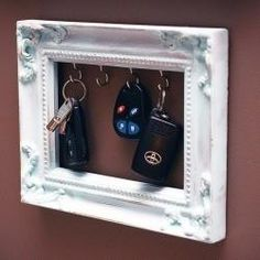 Great idea for a key holder  - Little hooks with an empty vintage frame around them