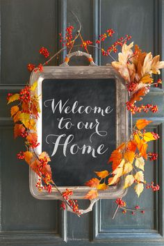To make this welcome sign, apply a layer of chalkboard paint to the inside of an old tray. Autumn branches and bittersweet berries add the perfect finishing touch.    - CountryLiving.com