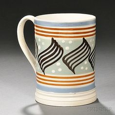 <b>Mocha-decorated Pearlware Quart Mug,</b> England, early 19th century, the blue mouth and base band bordering triple light brown slip bands and a light green field decorated with trailed with wavy brown lines and white slip dots, the extruded handle with foliate ends, ht. 5 7/8 in. <br /> <br /> Provenance: From the D.H. & S.E. Miller Collection.