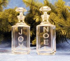 "Joy and Noel Decanters.  What better way to display your spirits during the holidays than in a beautiful decanter customized with whatever words you choose.  We selected the traditional ""Joy"" and ""Noel"" words for this projects, but you can select any word that will fit your decanter.  So possibilities are infinite!   http://www.etchtalk.com/Item/joy-and-noel-decanters"