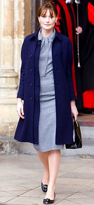 What to wear to work during autumn/winter.    Ms Carla Bruni: Channeling Audrey Hepburn in a skirt suit by Dior worn with a navy overcoat and accessories from the line.