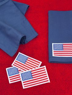 Customize solid red, white or blue cloth napkins with iron-on American flag patches.