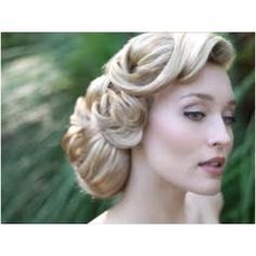 somewhat 1940's wedding hair. It's perfect and so elegant