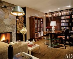 """The study. """"I used a bookcase by Ruhlmann as a point of departure for designing the shelves for the clients' books,"""" notes Montoya   archdigest.com"""