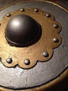 "LARP buckler for my bard. 13th century French style. 10"" diameter. Eva foam, plastidip, and acrylics."