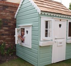 Playhouse with opening windows, stable door and letterbox
