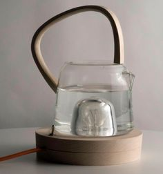Kettle heated by light bulb