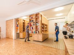 soooo many cool things here: a) modular living b) furniture c) small spaces d) plywood as a decorative element