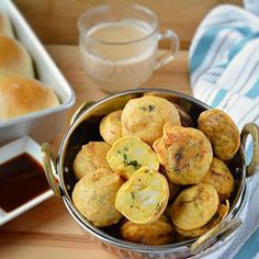Potato dumplings served with green chutney, tamarind chutney and stuffed in homemade buns- staple Mumbai street snack.