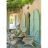 :) the sea drift teak chairs and the turquoise shutters
