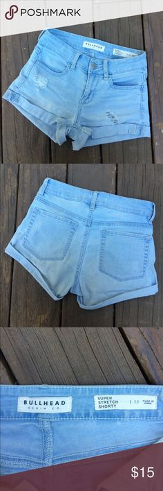 Distressed Light Wash Pacsun (Bullhead) Shorts Super comfortable and stretchy light wash, ripped shorts from Pacsun but from the Bullhead brand. They are in size 23 and in perfect condition. They are great quality and perfect for the summer as go with practically any shirt. Bullhead Shorts Jean Shorts