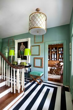 A sleek painted floor breathes new life into hardwoods. This fun pattern keeps the eye moving and compliments the fun wall and trim color. Gold accents add a touch of seriousness to this playful foyer. With an eye for detail, a painted floor is a simple DIY. Get the instructions.