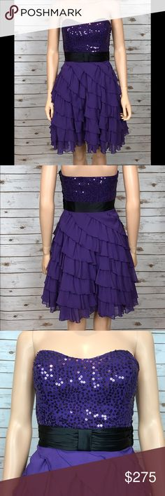 Purple Betsey Johnson Dress Sz.4 This dress is beautiful!! The deep royal purple is gorgeous and it makes it so it can be worn any time of the year. The skirt is tiered ruffles, which come across very feminine. The bodice is sequined with a black band separating it from the skirt. It is a size 4 and never been worn. Attached are the tags and the strap that allows you to turn the dress from a strapless to one with straps. Betsey Johnson Dresses Strapless