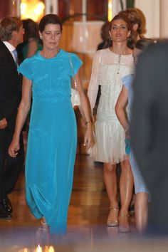 Princess Caroline and Charlotte Casiraghi leave for the concert; wedding of Prince Albert of Monaco and ms Charlene Wittstock