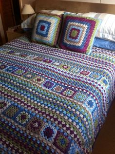 Awesome granny square and rows in blues, purple, browns and greens from http://crochetime.net/2012/01/07/identity-crisis-blanket-ta-daaaaah/