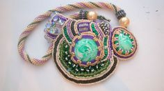 Bead embroidery necklace: polymer clay cabs decorated with beads and bug...