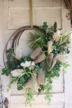 Lariat Rope Western Rope Wreath with burlap, greenery, and feathers