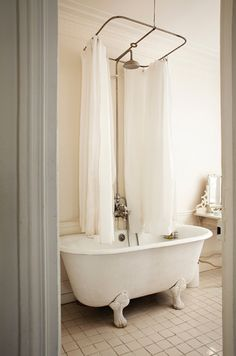 Almost chose a place with a claw foot tub and curtain just like this. I want to steal it away