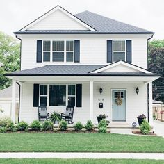 A modern take of shabby chic crossed with farmhouse soul. That blue door and wreath are just spot on , and don't even get we started on those darling rocking chairs. Simple white siding, black shutters and blue front door Style At Home, Exterior House Colors, Exterior Design, Exterior Paint, Exterior Shutters, Siding Colors, Door Design, Simple House Exterior, Exterior Homes