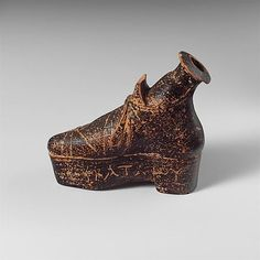 Alabastron, terracotta perfume vase in the shape of a shoe Inscribed with the owner's name Hekataiou. 1st C. BCE Lydian (in Hellenistic Turkey)