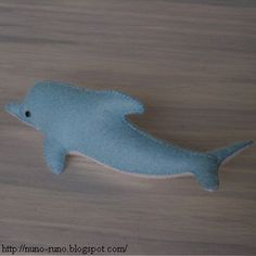 Stuffed dolphin of felt. 13 centimetres. It's simple and easy.   Cutting.   Sew up the back with blanket stitch.   Sew the upper jaw to the ...