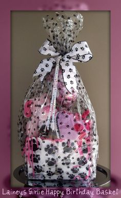 Pet themed gift baskets.  http://www.nashvillewraps.com/paw-print-packaging/showpage.ww?page=pawprint