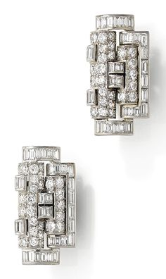 RENÉ BOIVIN - A pair of Art Deco platinum and diamond clips, French, circa 1935. Each measuring 2.6 x 1.8cm. #Boivin #ArtDeco #clip