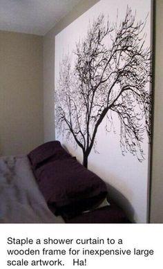 Put a pretty shower curtain on a wood frame for cheap art.