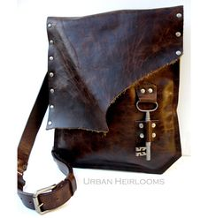 Hey, I found this really awesome Etsy listing at http://www.etsy.com/listing/152629245/brown-leather-messenger-bag-with-antique