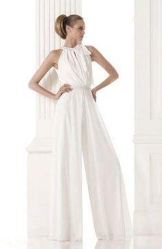 modern white bridal pantsuit with wide leg pants and bow tied around collar   mywedding.com